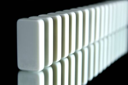 upright row: a row of white dominoes on black