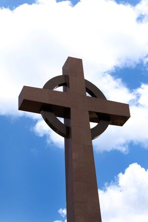 A huge Granite cross with a sky background