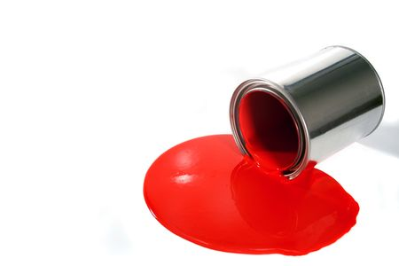 paintbucket: a spilled red paint bucket Stock Photo