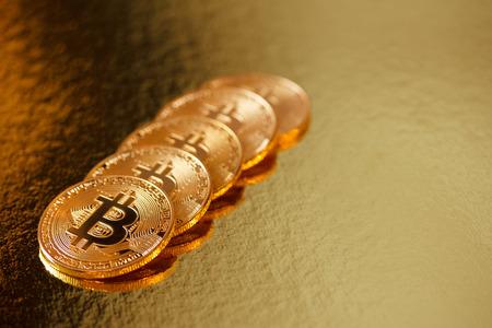 Golden bitcoin on a gold background 免版税图像