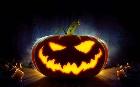 Happy Halloween design poster with pumpkin 2018. Spooky forest with dead trees and pumpkins. Evil, glowing smile carved on a pumpkin on a dark background. In anticipation of the holiday. 3d render Standard-Bild