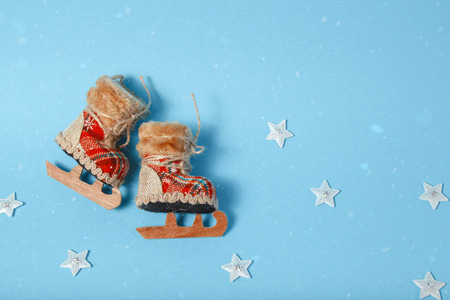 Christmas tree toy skates. Holiday celebration concept on a blue background.