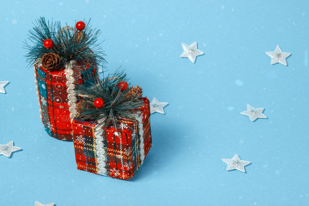 Christmas tree toy box, cylinder. Holiday celebration concept on a blue background.