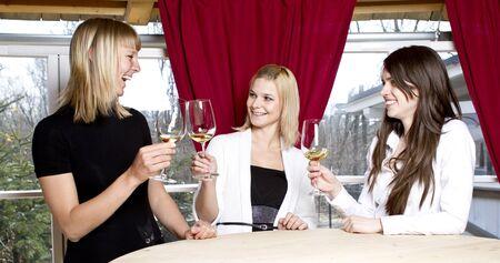 Girls having drink in bar Stock Photo