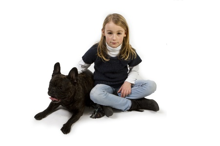 French bulldog and little girl playing isolated on white background