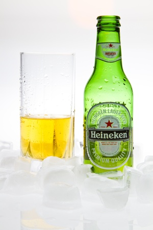 Heineken beer with glass and ice isolated studio shot