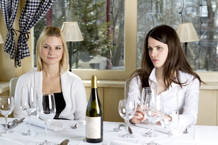 Beautiful young girls having a dinner in restaurant Stock Photo - 9159224