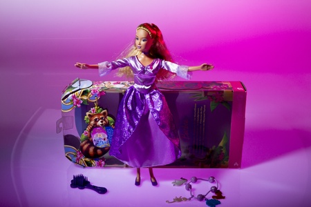 Barbie doll from Matell on pink and red background Editorial