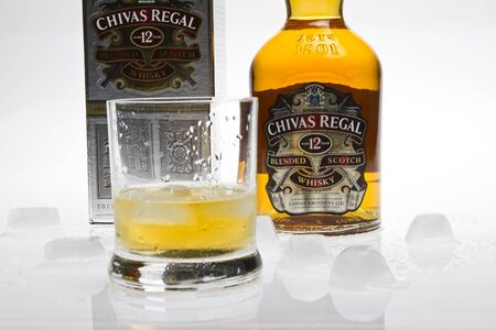 Chivas Regal Whisky isolated with glass and ice