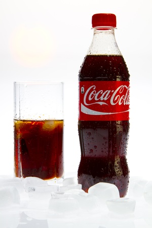 Coca Cola  with glass and ice on white background