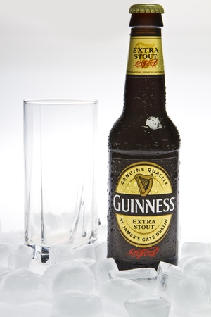 Guinness Beer with glass and ice isolated studio shot Editorial
