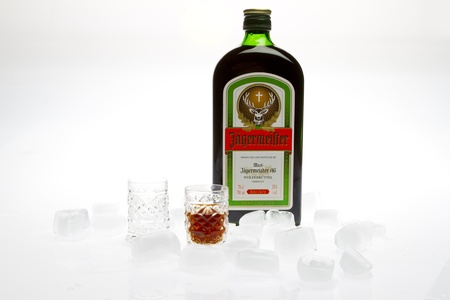 Jagermeister with glass and ice studio shot