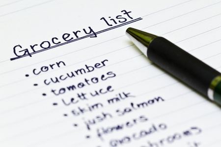 Grocery list with metal ball point pen Stock Photo