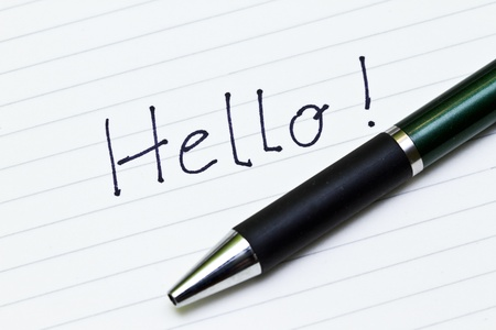 Hello sign on list of paper with ball pen Stock Photo