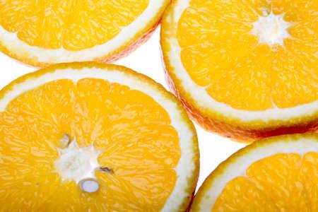 Fresh slices of oranges isolated on white studio shot