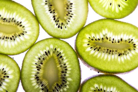 Kiwi fruit slices isolated on white studio shot