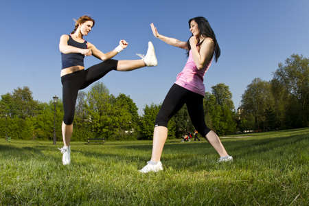 Karate fight between young girls in the park Stock Photo