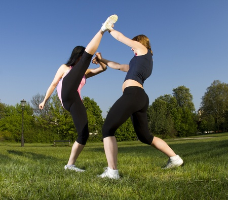 Karate fight between young girls in the park Stock Photo - 9390308
