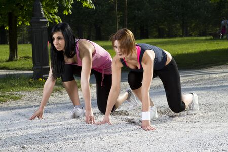 Young girls in sprinting position