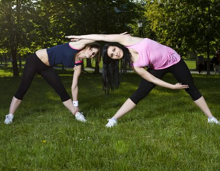 Young girls streching after exercise