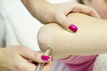 Young girl at beatuy salon having elbow skin peel