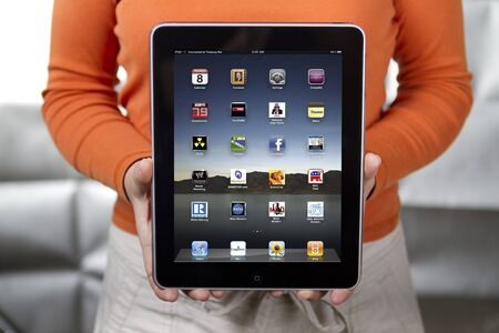 Woman holding Apple iPad