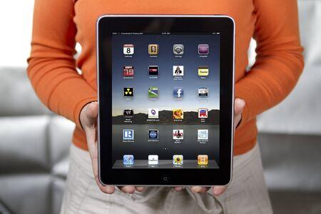 Woman holding Apple iPad