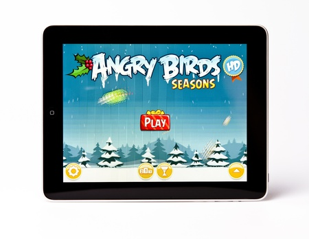 editorial: Apple iPad  editorial studio shot with Angry Birds on background Editorial