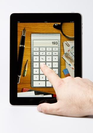 editorial: Apple iPad  editorial studio shot with Calculator on background