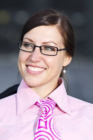 Pretty young woman manager in a neck tie outdoor shot Stock Photo