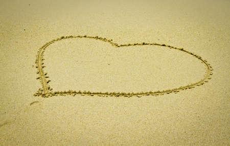 Heart shape in the sand on the beach