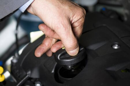 Oil change at the car shop Editorial