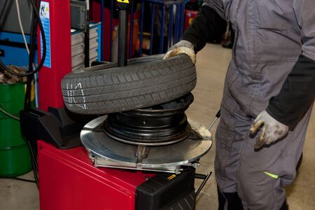 flat tyre: Tire change At the machanic shop Editorial