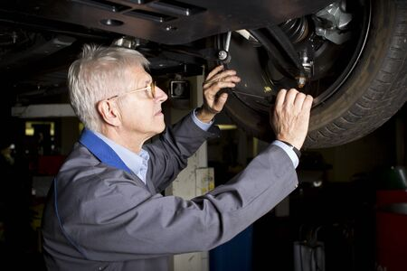 Car mechanic under the car Stock Photo