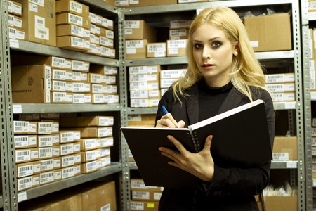 Business Woman doing inventory  Stock Photo
