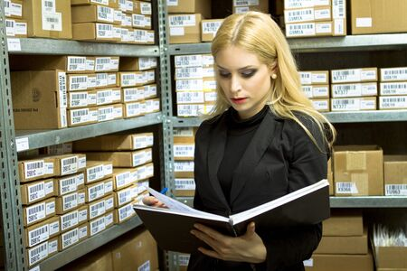 Young Business Woman doing inventory photo