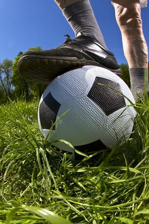 Senior football player with his ball