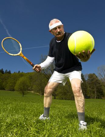 Senior tennis player in the park