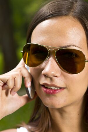Young business woman with telephone