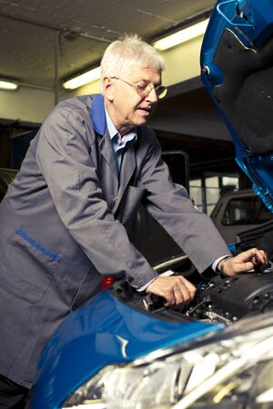 Car mechanic in the work shop Stock Photo