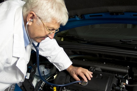 Car Doctor in the mechanic shop Stock Photo