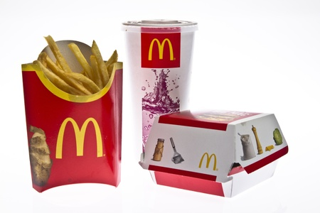 Ljubljana, Slovenia - 21. april, 2011. McDonalds Big Mac value meal isolated on a white background. A Big Mac, fries and a coke sitting on a reflective surface.