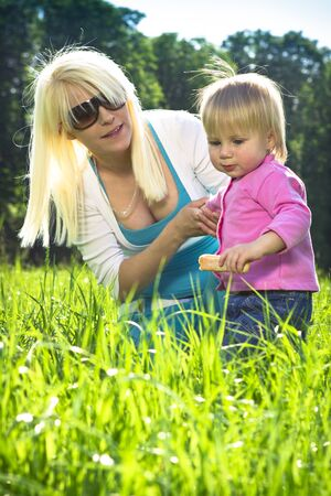 Mother and a child playing in the grass
