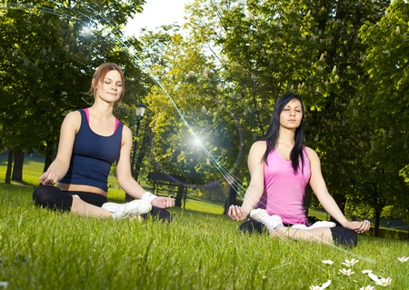 Girls meditating in the park