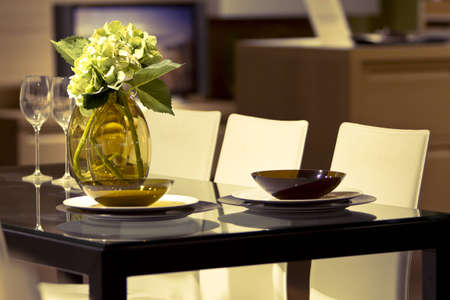 Modern dining room with table and flowers Stock Photo