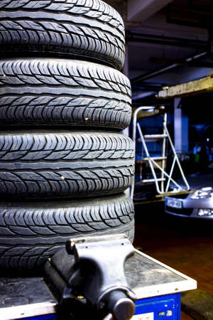 Stacked car tires at the mechanic shop Stock Photo