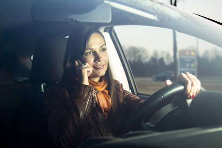 carelessness: Woman talking on the phone while driving