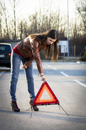 Woman with broken car seeking help Stock Photo