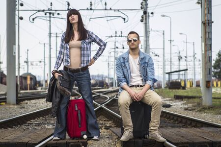 Young couple waiting for the train in lost station Stock Photo