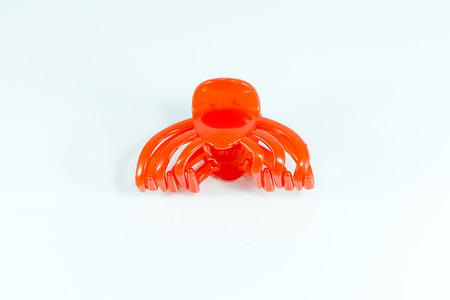 women's issues: Hair clip isolated on a white background.